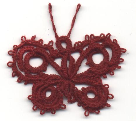 Carolyn Groves sample of Deaconess butterfly from 1916 order of work, larger thread